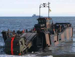 Lorry drives off landing craft
